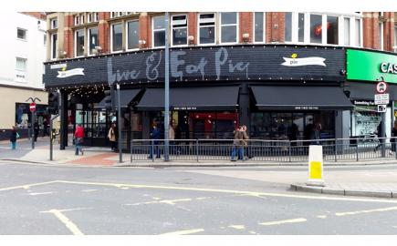 Traditional awning styling for contemporary pie and mash shop